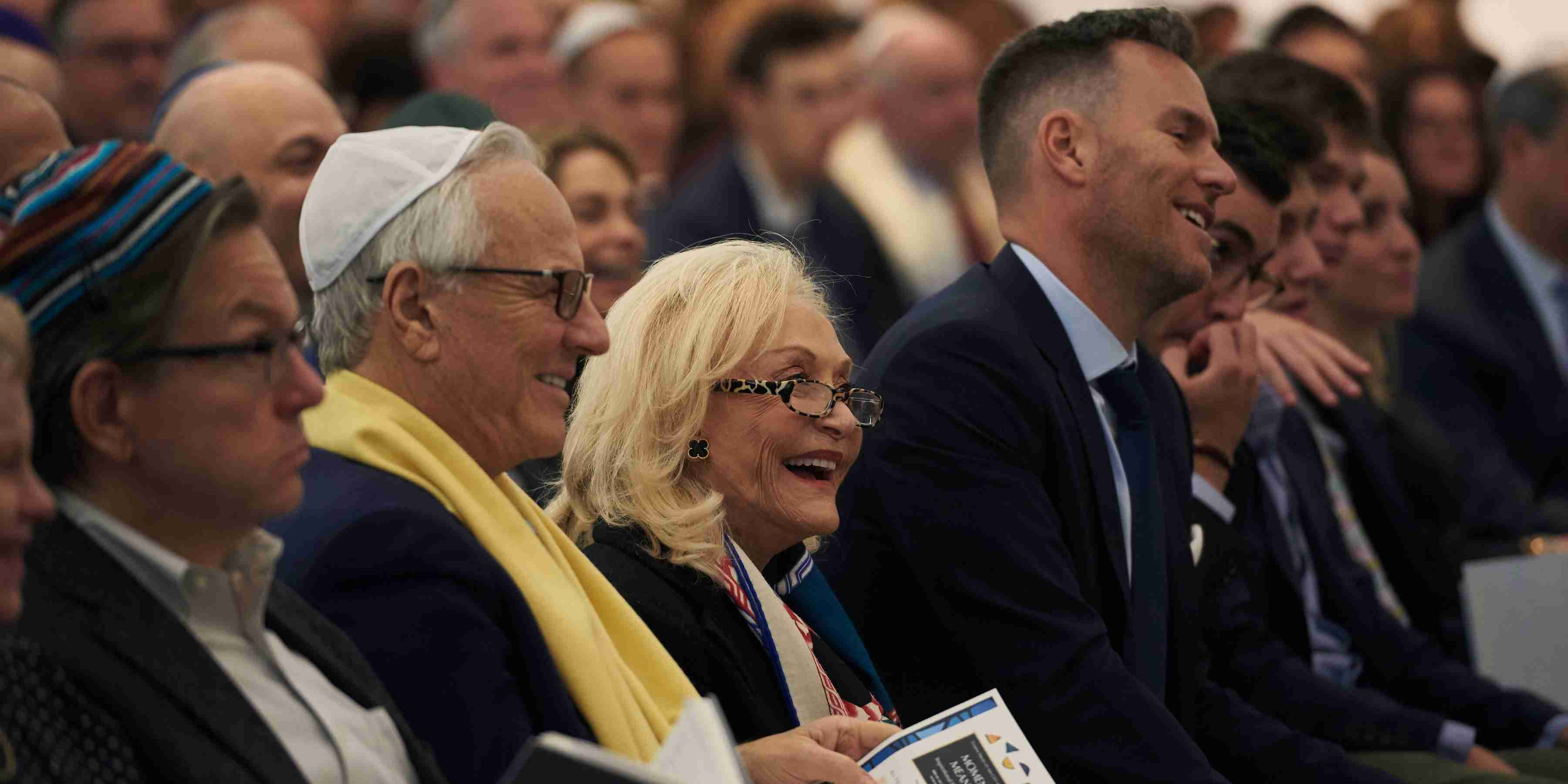 Seated row of congregants laughing